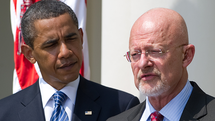 US President Barack Obama stands alongside General James Clapper (AFP Photo / Saul Loeb)