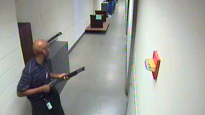 Aaron Alexis moves through the hallways of Building #197 carrying a Remington 870 shotgun in this undated handout photo released by the FBI (Reuters)