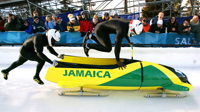 (FILE) Lascelles Oneil Brown (L) and Winston Alexander Watt of the Jamaica-1 team leap into their sled at the start of heat three of the two-man bobsleigh competition (Reuters / Peter Andrews)