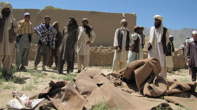 ARCHIVE PHOTO: Afghan villagers stand at a house which was hit by a airstrike in Sajawand village in Logar province, south of Kabul (Reuters / Sabawoon Amarkhil)