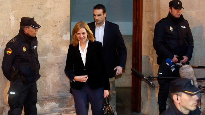Spain's Princess Cristina, daughter of King Juan Carlos, leaves a courthouse after testifying in front of judge Jose Castro over tax fraud and money-laundering charges in Palma de Mallorca February 8, 2014 (Reuters / Albert Gea)