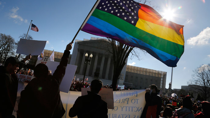 ARCHIVE PHOTO: Anti-Proposition 8 protesters wave a rainbow flag in front of the U.S. Supreme Court in Washington, March 26, 2013 (Reuters / Jonathan Ernst)