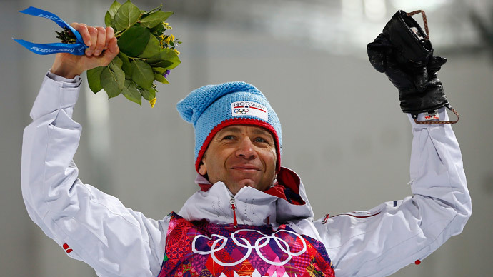 Winner Ole Einar Bjoerndalen of Norway celebrates during the flower ceremony for the men's biathlon 10 km sprint event at the Sochi 2014 Winter Olympics in Rosa Khutor February 8, 2014 (Reuters / Carlos Barria)