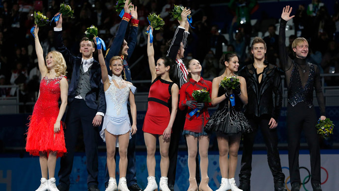 Russian figure skating team, gold medal, celebrates on the podium during the Figure Skating Team Flower Ceremony at the Iceberg Skating Palace during the Sochi Winter Olympics on February 9, 2014.(AFP Photo / Adrian Dennis)
