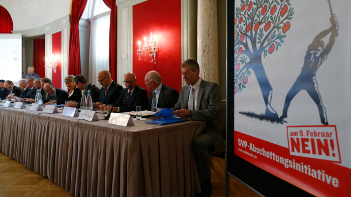 Directors and President's of Swiss industry, employer associations, science industries, Swissmem and economiesuisse attend a Swiss People's Party (SVP) news conference about their 'stop mass immigration' initiative in Bern January 6, 2014 (Reuters / Ruben Sprich)