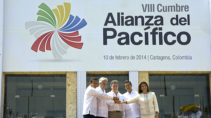 Family photo of presidents (L to R):  Peru's Ollanta Humala, Chile's Sebastian Pinera, Colombia's Juan Manuel Santos, Mexico's Enrique Pena Nieto and Costa Rica's Laura Chinchilla at the convention center in Cartagena, Colombia on February 10, 2014. (AFP Photo / Luis Acosta)