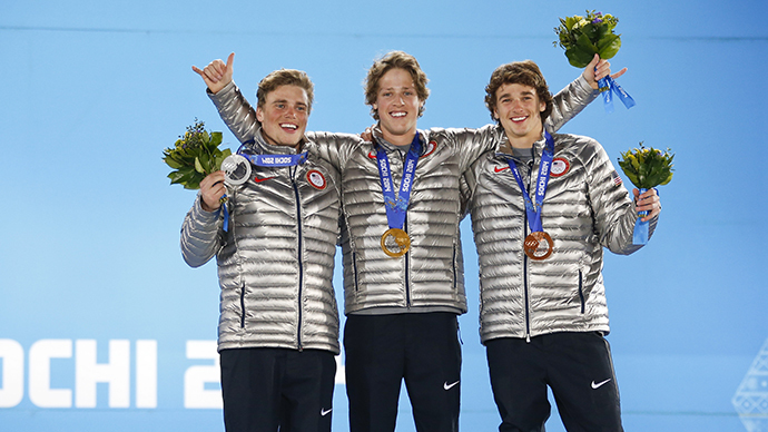 Gold winner Joss Christensen (C), silver medalist Gus Kenworthy (L) and bronze medalist Nicholas Goepper of the U.S. celebrate during the medal ceremony of the men's freestyle skiing slopestyle finals at the 2014 Sochi Winter Olympics, February 13, 2014. (Reuters / Eric Gaillard)