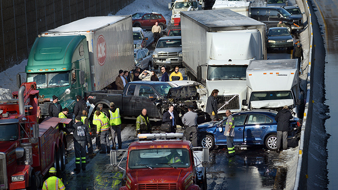 Rescue and fire personnel assist on the scene of a 100 car chain reaction pileup accident on the Pennsylvania Turnpike eastbound February 14, 2014 in Feasterville, Pennsylvania. (AFP Photo / William Thomas Cain)