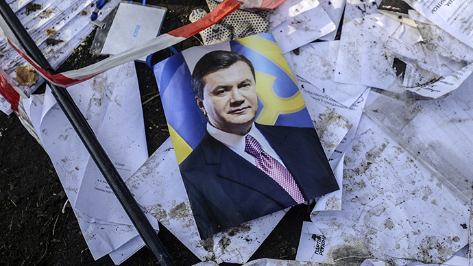 A picture of Ukraine's President Viktor Yanukovich is seen on the ground in Kiev, February 21, 2014. (Reuters / Andrew Kravchenko)