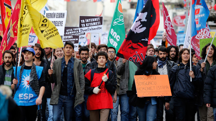 Protesters shout slogans, hold banners and wave flags as they demonstrate against new controls on the Internet approved by the Turkish parliament in Ankara February 22, 2014. (Reuters / Umit Bektas)