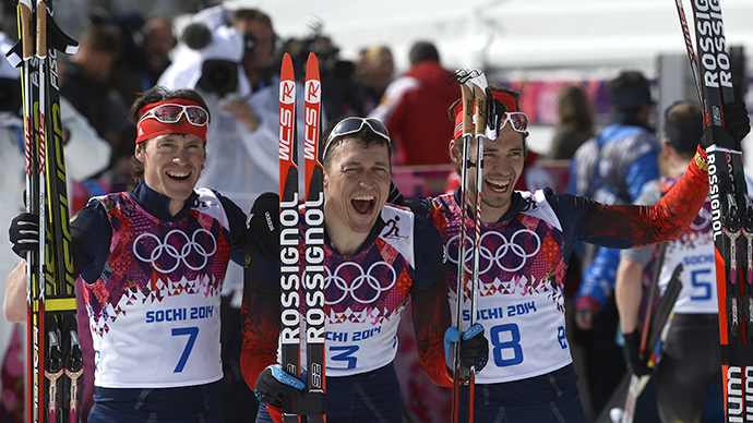 Silver medalist Russia's Maxim Vylegzhanin (7) gold medalist Russia's Alexander Legkov (3) and Bronze medalist Russia's Ilia Chernousov (8) (AFP Photo / Pierre-Philippe Marcou)