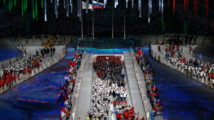 Olympic athletes enter the stadium during Closing Ceremony of the Sochi Winter Olympics at the Fisht Olympic Stadium on February 23, 2014. (AFP Photo / Adrian Dennis)