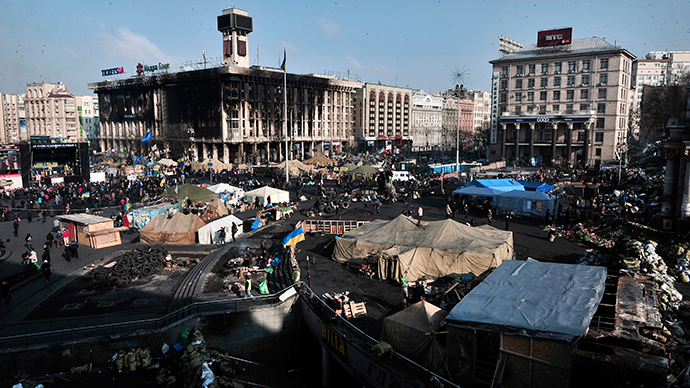 "A view of the anti-government protesters camp at Kiev's Independence Square on February 24, 2014. Ukraine issued an arrest warrant for ousted president Viktor Yanukovych on Monday as the country's new rulers launched a probe over the ""mass murder"" of protesters in a week of carnage in Kiev (AFP Photo / Louisa Gouliamaki)"