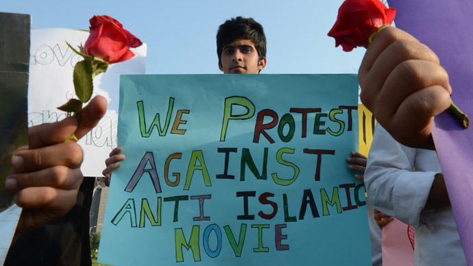 "A Pakistani student holds a placard during a protest against the controversial film ""Innocence of Muslims"" in Islamabad (AFP Photo / Farooq Naeem)"