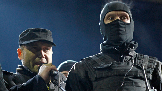 ARCHIVE PHOTO: Dmytro Yarosh (L), a leader of the Right Sector movement, addresses during a rally in central Independence Square in Kiev February 21, 2014 (Reuters / David Mdzinarishvili)