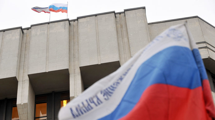 Russian flags flutter atop and in front of the local parliament building in Simferopol, Crimea (AFP Photo/Genya Savilov)