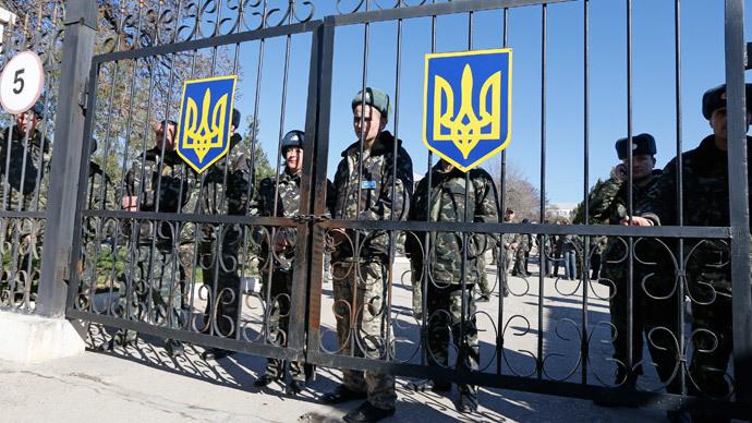 Ukrainian servicemen on the territory of their military unit located some 80 km (50 miles) southwest of Simferopol, Crimea's capital, March 3, 2014. (Reuters / Vasily Fedosenko)