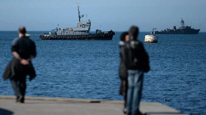 Russian Navy ships pass by Sevastopol harbour on March 3, 2014. (AFP Photo / Filippo Monteforte)