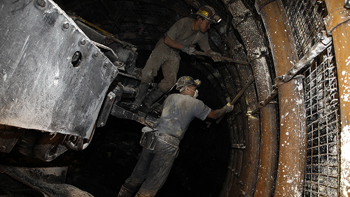 File photo. Miners work in the extraction gallery. (Reuters / Peter Andrews)