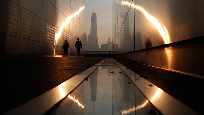 A man walks through the 9/11 Empty Sky memorial across from New York's Lower Manhattan and One World Trade Center in Liberty State Park (Reuters / Gary Hershorn)