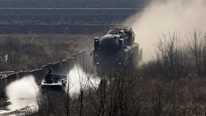 A Topol missile launcher (R) (Reuters / Denis Sinyakov)