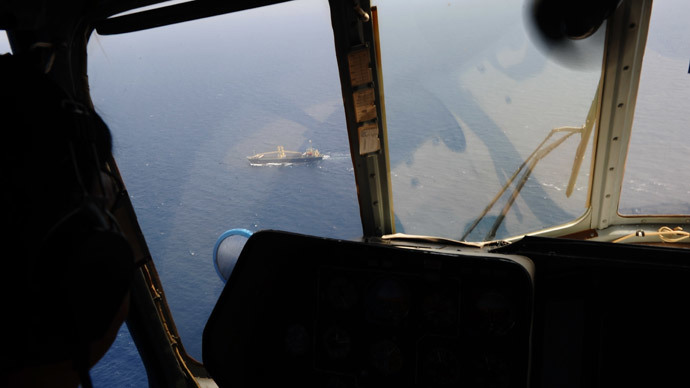 This aerial picture taken from aboard a Vietnamese Air Force Russian-made MI-171 helicopter shows a ship, as seen from the cockpit, sailing below during a search flight some 200 km over the southern Vietnamese waters off Vietnam's island Phu Quoc on March 11, 2014 as part of continued efforts aimed at finding traces of the missing Malaysia Airlines MH370.(AFP Photo / Hoang Dinh Nam)