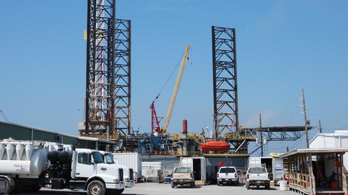 An offshore platform docked in Port Fourchon, Louisiana (AFP Photo / Mira Oberman)