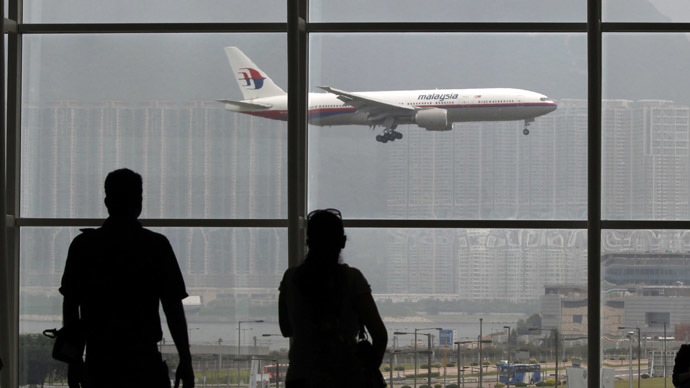 A Malaysia Airlines Boeing 777 plane is seen from the departure hall at the Hong Kong International Airport June 2, 2011. (Reuters/Bobby Yip)