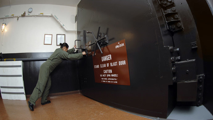 Minot Air Force Base : This handout image provided by the US Air Force, shows 1st Lt. Theresa Lau closing the first of two blast doors of the underground launch control center (LCC) (AFP Photo)