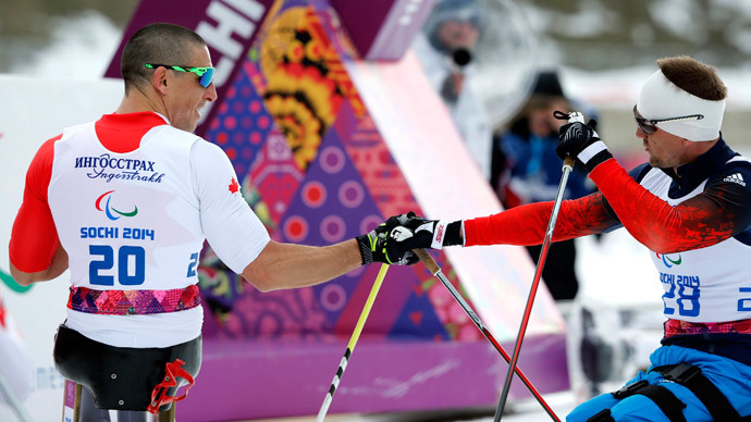 Russia's Roman Petushkov (R) congratulates Canada's Chris Klebl after the men's 10 km cross-country sitting at the 2014 Sochi Paralympic Winter Games in Rosa Khutor, March 16, 2014. Klebl won the gold medal.(Reuters / Alexander Demianchuk)