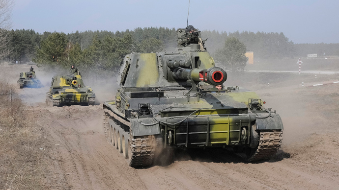 Ukrainian tanks take part in a military exercise near Kharkiv March 14, 2014 (Reuters / Stringer)