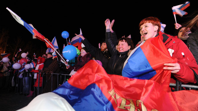 Pro-Russian Crimeans celebrate in Sevastopol on March 16, 2014 after partial votes showed that about 95.5 percent of voters in Ukraine's Crimea region supported union with Russia.(AFP Photo / Viktor Drachev)