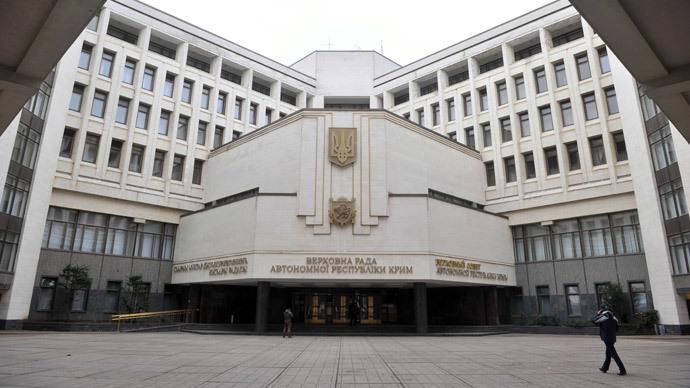 A man walks in front of the Crimean Parliament building in Simferopol.(AFP Photo / Genya Savilov)