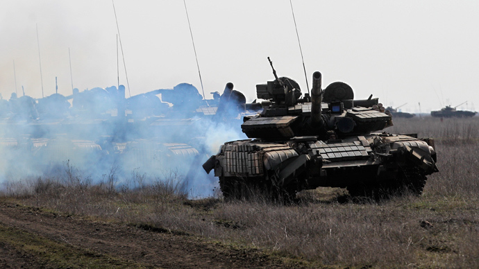 Tanks drive during a military drill conducted by Ukrainian servicemen near the city of Mykolaiv, also known as Nikolayev, in southern Ukraine, northwest of the Crimean peninsula March 14, 2014 (Reuters / Valentyn Ogirenko)