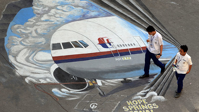 Mural featuring missing Malaysia Airlines flight MH370 in Manila. (AFP Photo / Ted Aljibe)