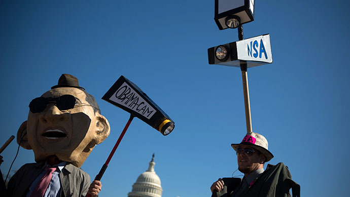 Protesters dressed up in costumes representing U.S. President Barack Obama and an National Security Agency agent rally in front of the U.S. Capitol building during the Stop Watching Us Rally protesting surveillance by the U.S. National Security Agency (AFP Photo / Allison Shelley)
