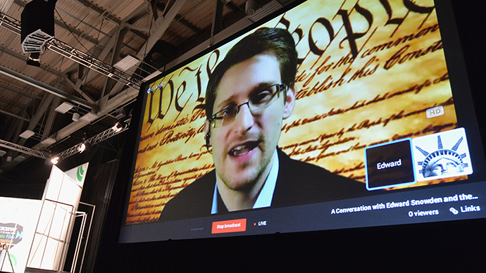 "NSA whistleblower Edward Snowden speaks via videoconference at the ""Virtual Conversation With Edward Snowden"" during the 2014 SXSW Music, Film + Interactive Festival at the Austin Convention Center on March 10, 2014 in Austin, Texas (AFP Photo)"