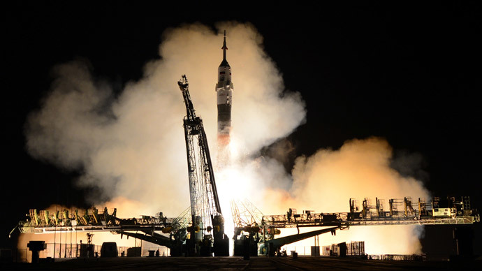 Russian Soyuz-FG rocket with the Soyuz TMA-12M spacecraft and a crew of US astronaut Steven Swanson, Russian cosmonauts Alexander Skvortsov and Oleg Artemyev aboard, blasts off from a launch pad at the Russian-leased Baikonur cosmodrome in Kazakhstan, early on March 26, 2014. (AFP Photo / VAasily Maximov)