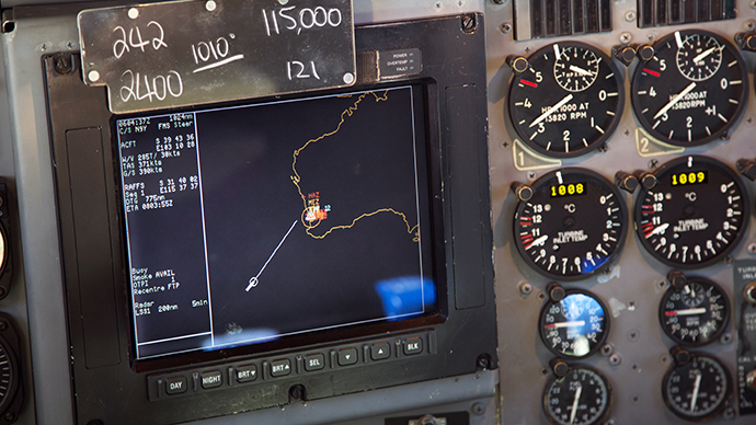 A navigation screen used by pilots aboard a Royal Australian Air Force AP-3C Orion aircraft shows their current location represented by a white circle during their mission to search for the missing Malaysian Airlines flight MH370 over the southern Indian Ocean on March 27, 2014. (AFP Photo / Michael Martina)
