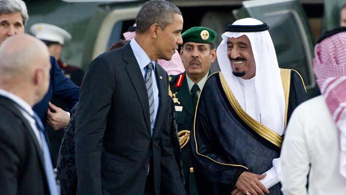 US President Barack Obama (C-L) is greeted by Saudi Crown Prince Salman bin Abdulaziz al-Saud (C-R) upon his arrival at Rawdat Khurayim, the monarch's desert camp 60 miles (35 miles) northeast of Riyadh ahead of a meeting with Saudi King Abdullah, on March 28, 2014.(AFP Photo / Saul Loeb)