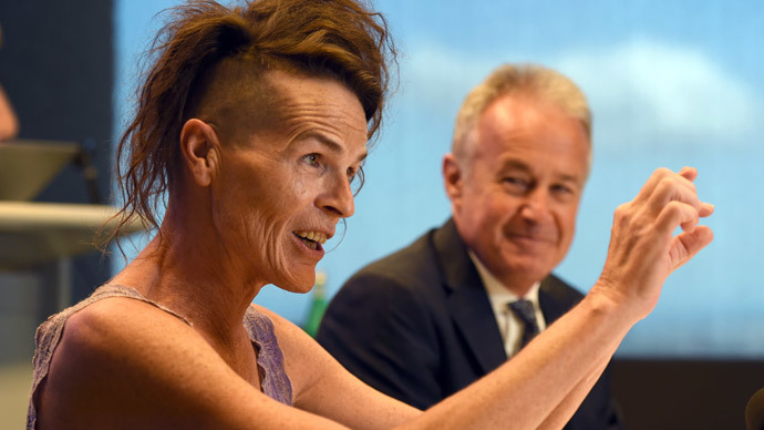 Norrie (L), who uses only a first name and does not identify as either male or female, speaks at a press conference with her lawyer Scott McDonald (R) in Sydney on April 2, 2014. (AFP Photo / William West)