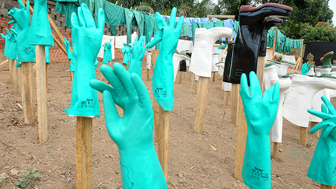 A view of gloves and boots used by medical staff, drying in the sun, at a center for victims of the Ebola virus in Guekedou, on April 1, 2014. (AFP Photo / Seyllou)
