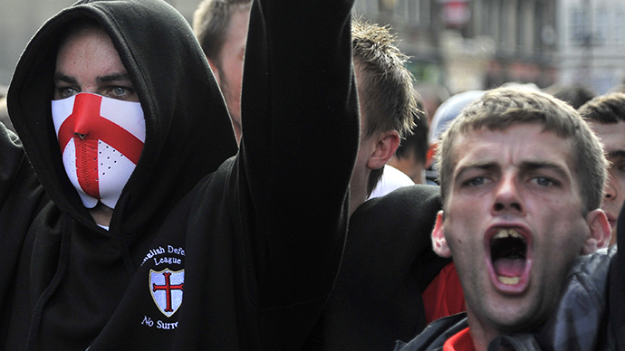 Demonstrators from the far-right English Defence League (EDL) stand in front of police lines during a protest in east London (Reuters / Toby Melville)