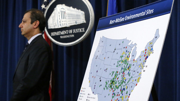 U.S. Attorney for the Southern District of New York Preet Bharara stands beside a map during an announcement of a settlement with Anadarko Petroleum Corp at the Justice Department in Washington April 3, 2014.  (Reuters/Jonathan Ernst)