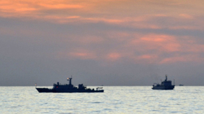A handout photo shows two Chinese surveillance ships which sailed between a Philippines warship and eight Chinese fishing boats to prevent the arrest of any fishermen in the Scarborough Shoal, a small group of rocky formations whose sovereignty is contested by the Philippines and China, in the South China Sea, about 124 nautical miles off the main island of Luzon April 10, 2012. (Reuters)