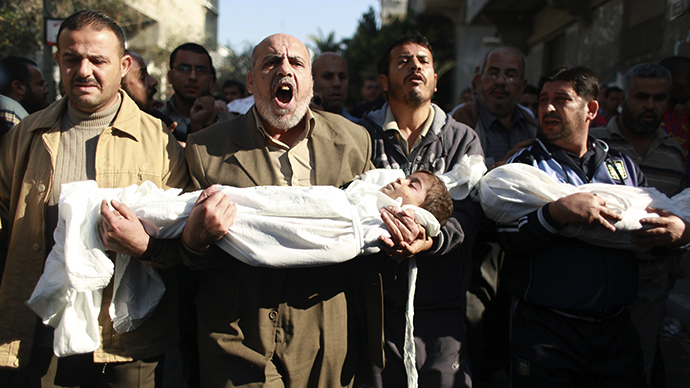 Palestinians carry the bodies of two boys Suhaib and Mohammed (R) Hejazi during their funeral in Beit Lahiya in the northern Gaza Strip November 20, 2012. (Reuters / Mohammed Salem)