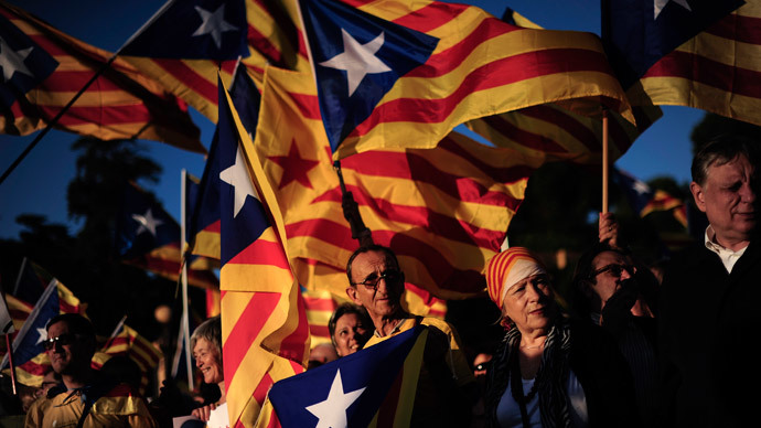 Demonstrators hold Catalan independentist flags during a protest as part of a campaign for independence from Spain, at the Pedralbes Palace in Barcelona during the first Economic Forum of the Western Mediterranean on October 23, 2013.(AFP Photo / Josep Lago)
