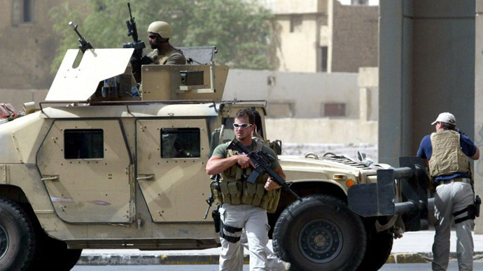 A picture taken on July 5, 2005 shows contractors of the US private security firm Blackwater securing the site of a roadside bomb attack near the Iranian embassy in central Baghdad. (AFP Photo / Ahmad Al-Rubaye)