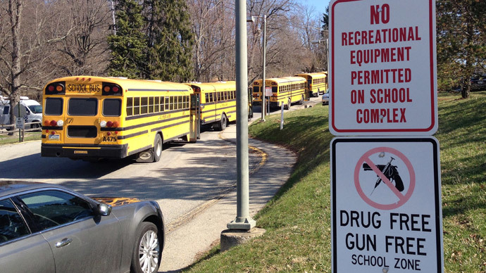 School buses are parked outside Franklin Regional High School after reports of stabbing injuries in Murrysville, Pennsylvania April 9, 2014. (Reuters / Elizabeth Daley)