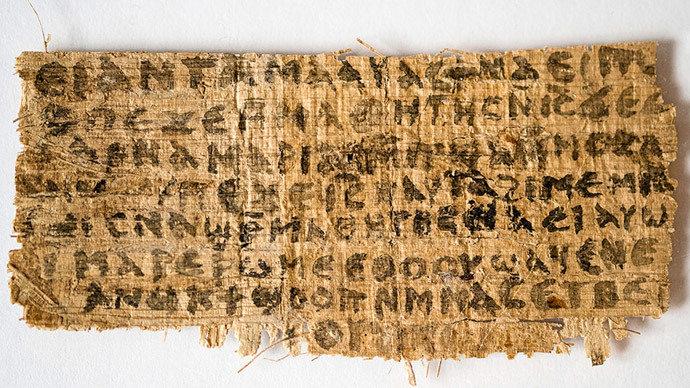 Hollis Professor of Divinity at the Harvard Divinity School in Cambridge, Massachusetts, shows the front side of a fourth-century papyrus fragment.(AFP Photo / Karen L. King)